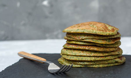 Stack of healthy spinach protein pancakes