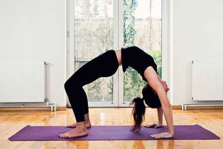 Woman doing yoga backbend